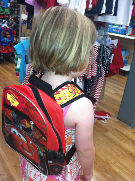 "Beatrix sporting the ""red pack-pack"" she insisted she needed for her first day of ""school"" (day camp)."