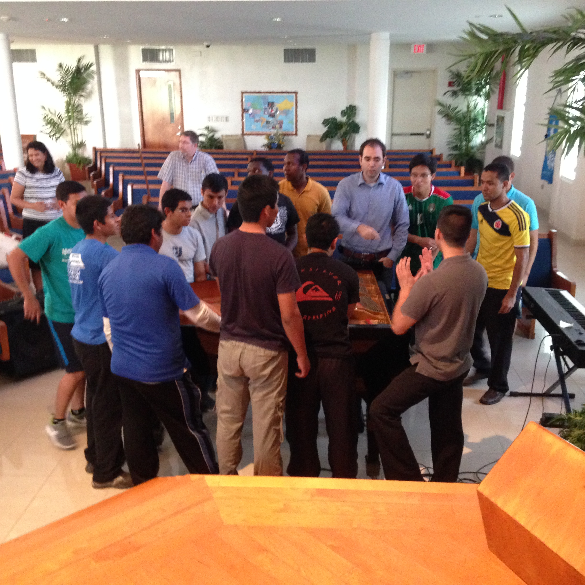 Moving the piano to the platform for the concert.  These guys are all students at Puerto Rico Baptist College.