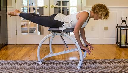 woman on pilates chair