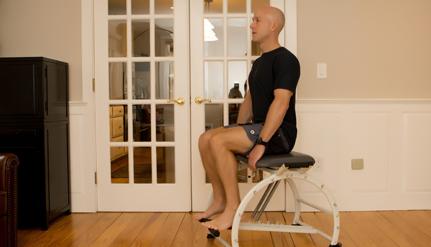 man on pilates chair