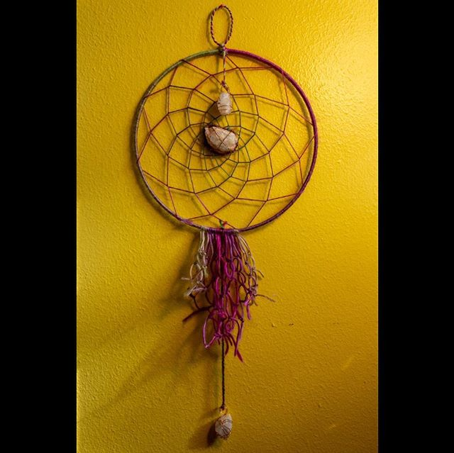 Dream catcher with wire wrapped raw quartz for sale on my website! For each dream catcher sold $5 is donated to the Native American Rights Fund