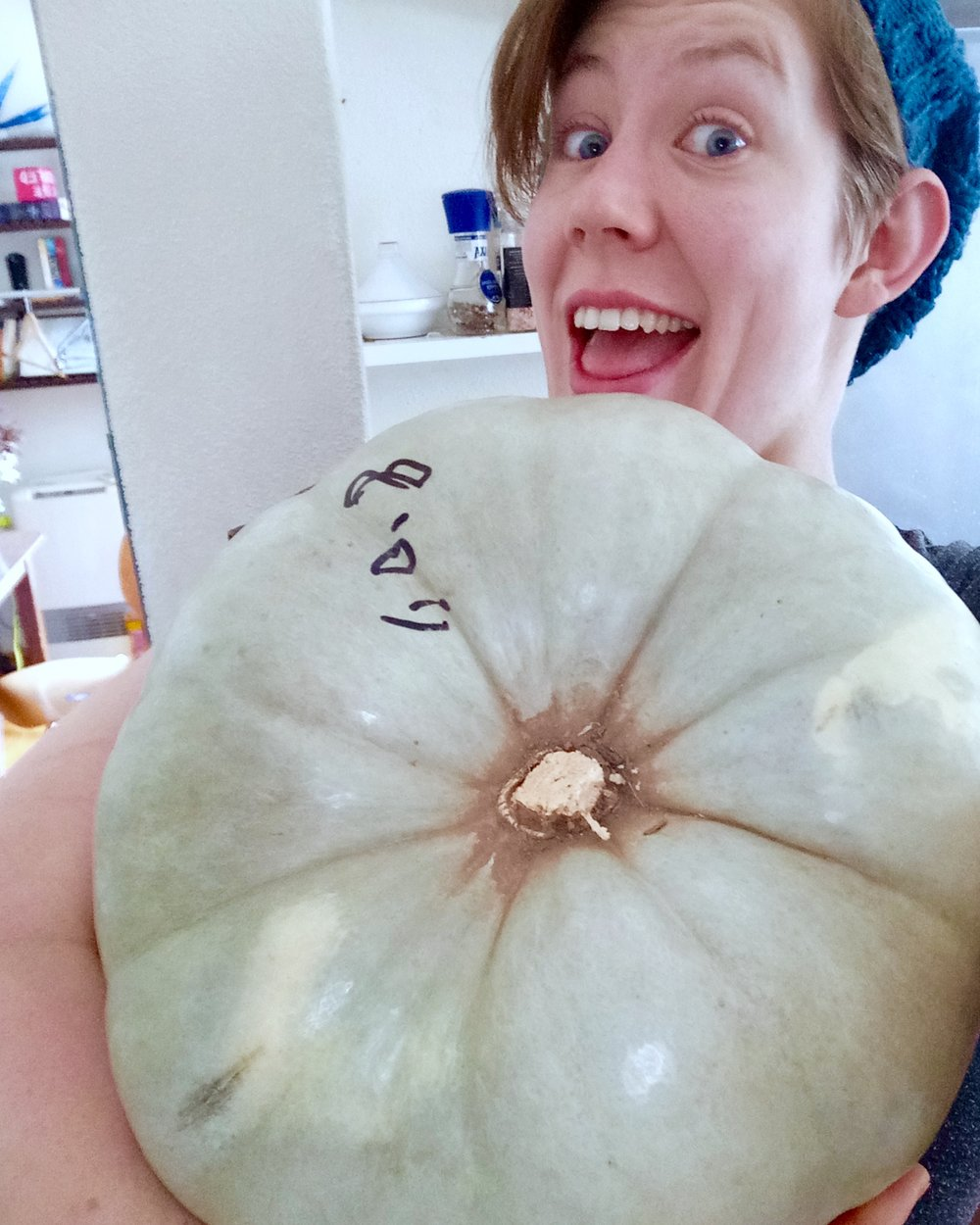 This should give you an idea of the size of our gargantuan pumpkin. My face for scale.