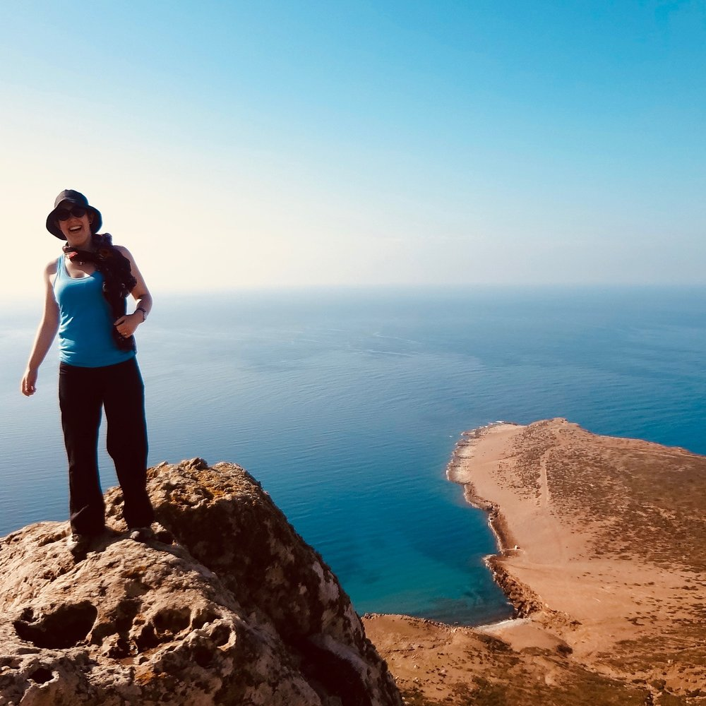 This is me at the Northernmost tip of Tunisia. I assume I'm laughing because Sicily is stubbornly NOT visible and I'm about to be blown off a cliff by strong winds.