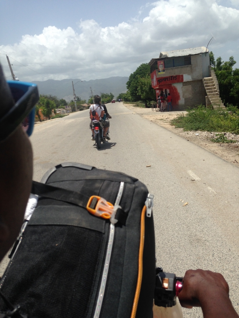 arriving on motos in Batey Isabela