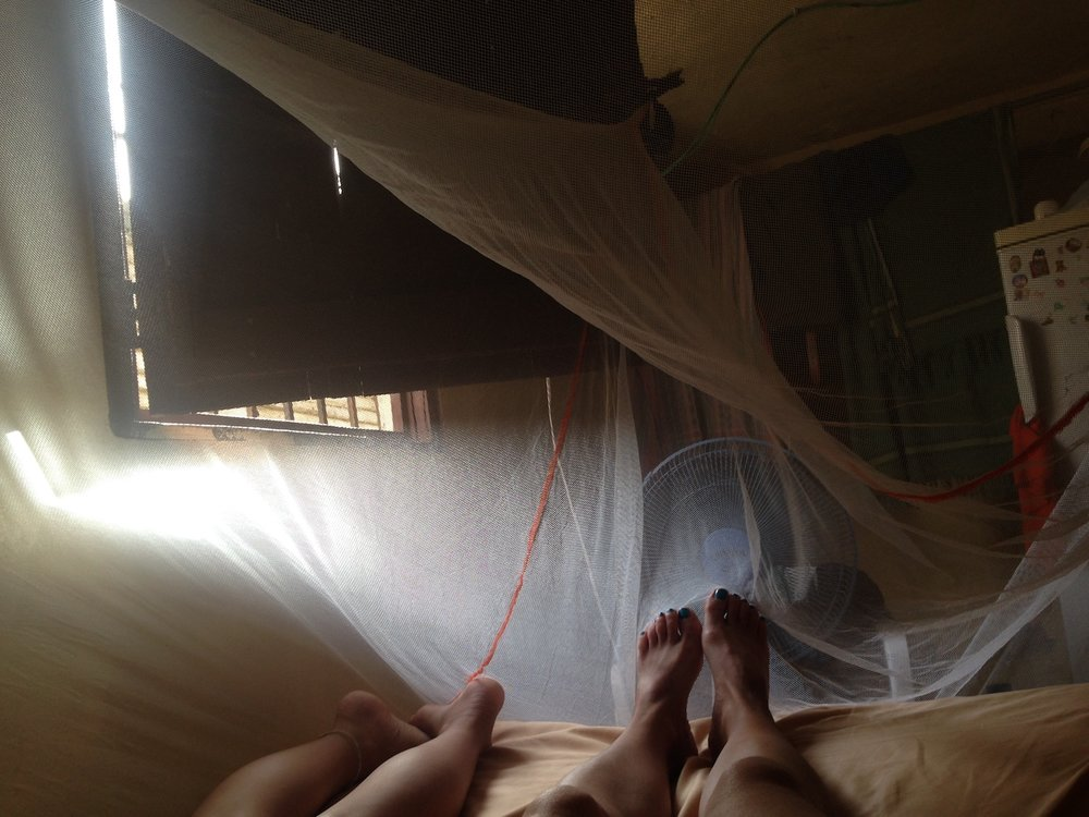 our feet under the mosquito net