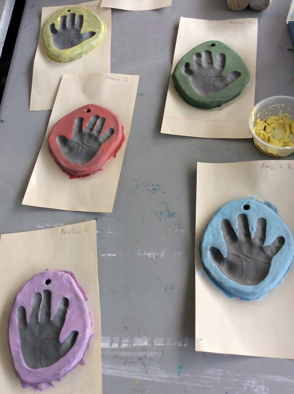baby hands in clay.JPG