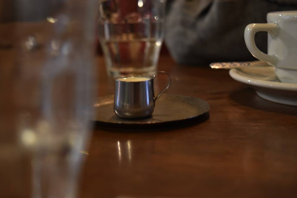 The tiniest milk jug.  - Yuki ordered coffee, and it came with the tiniest milk jug in the entire world. After pouring all the milk, he stuck his thumb in it, and we all came to a conclusion that that's how they wash the jug. The more you know.