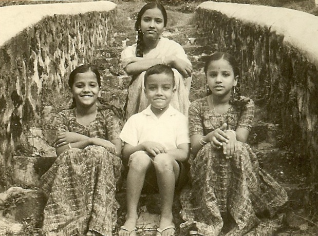 Sitting with three of my older sisters in Ooty, India in 1965. Shortly after this photo was taken, my sister Suda (right) died of Typhoid, at the age of 11. The use of antibiotics was not widespread in India at the time.