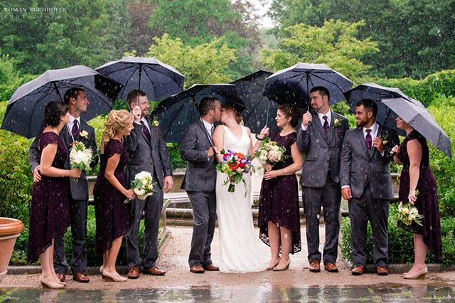 When it pours on your wedding day, you just gotta embrace it :)