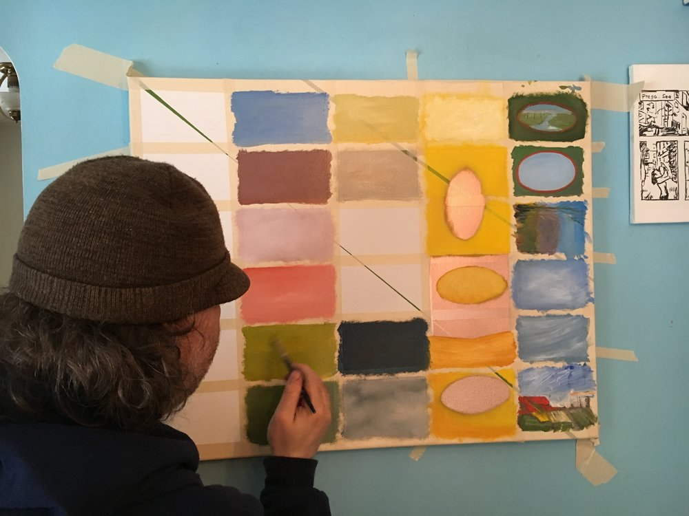 Michael builds a color story on the canvas.