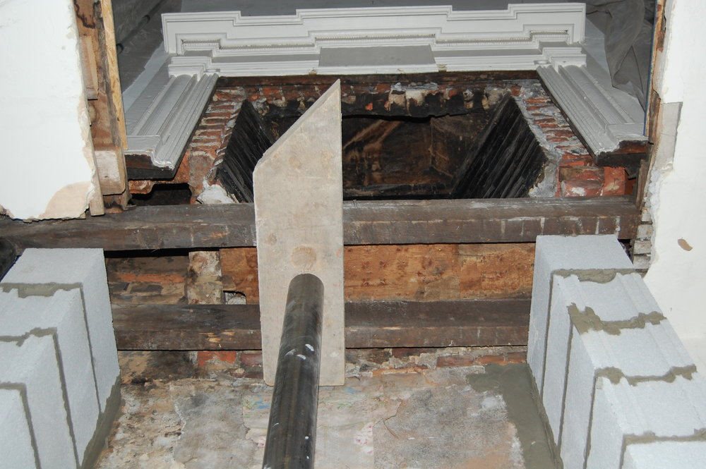 Structural support for historical fireplace