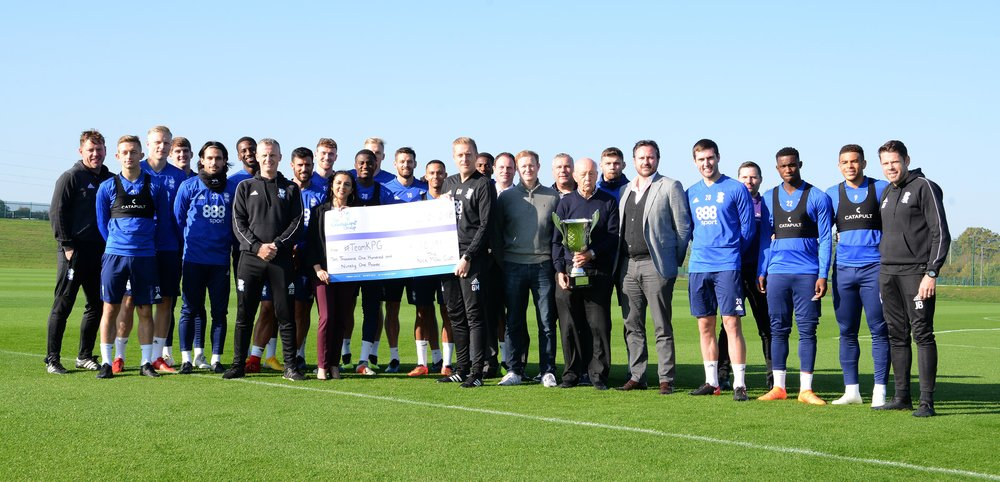 Garry Monk and the Birmingham City staff and players presenting the proceeds of the 2018 Nick Mowl Cup to Kaleidoscope Plus.