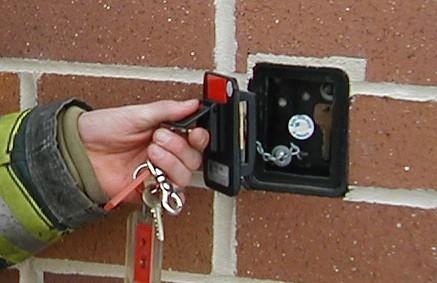 Building keys stored securely inside a recess mounted Knox Box