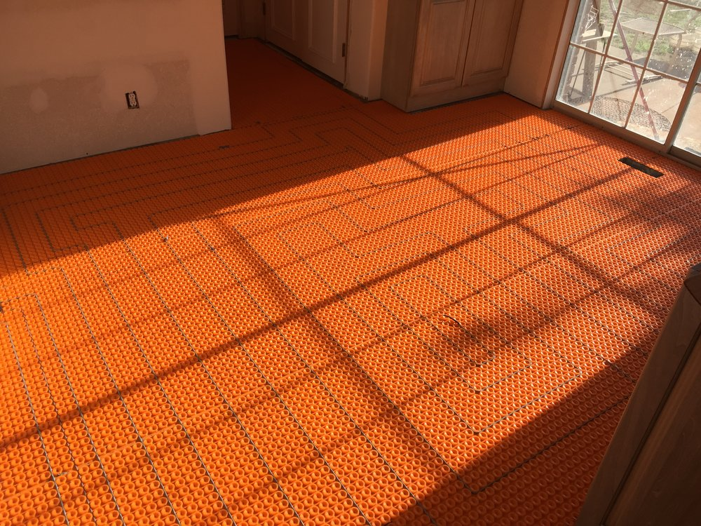 Underlayment for heated tile floors