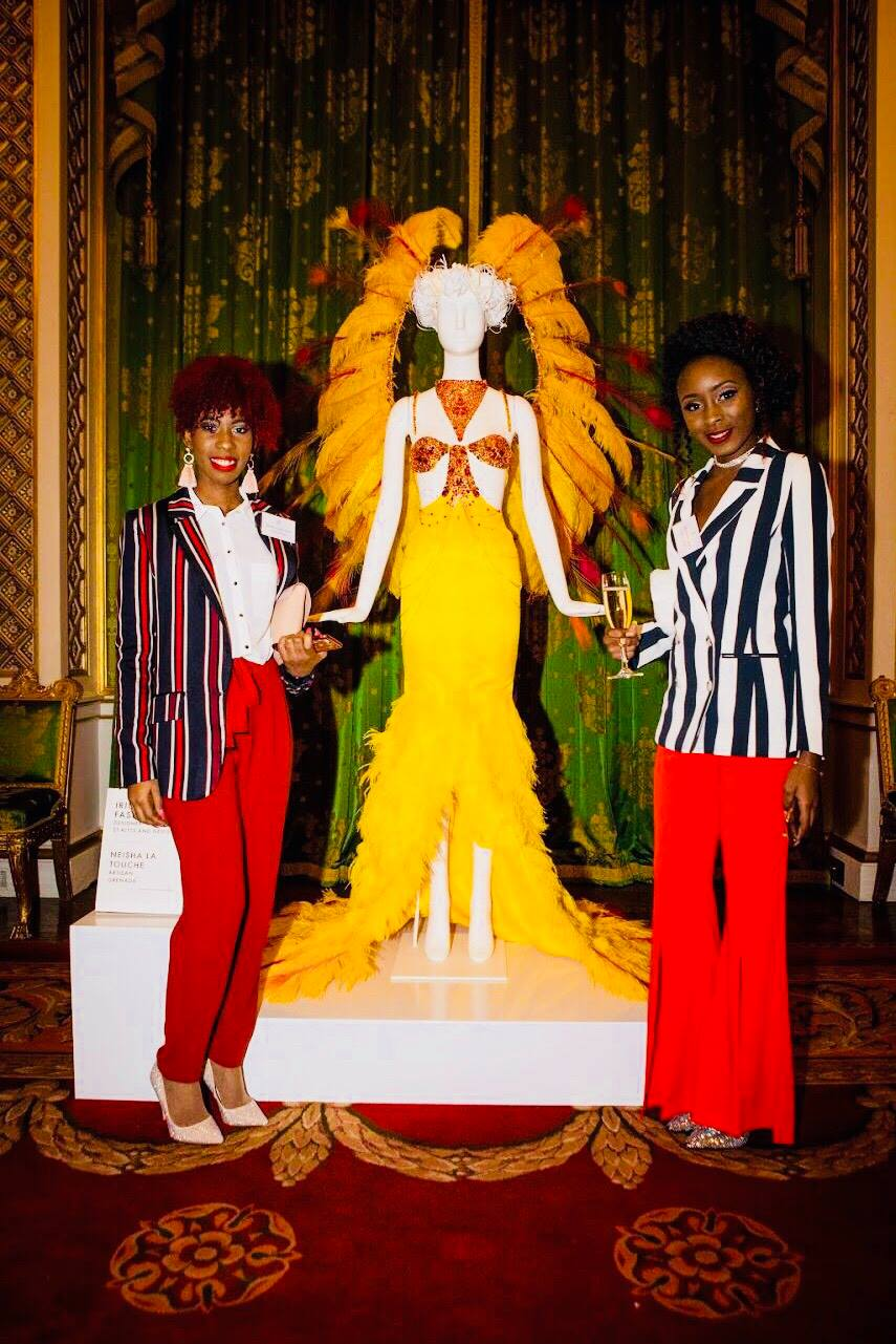 Keanna and Shavi pose in front of their design at The Fashion Exchange, an event at Buckingham Palace that showcased designers from Commonwealth nations. (Courtesy of Shavaniece Lake and Keanna Ible)