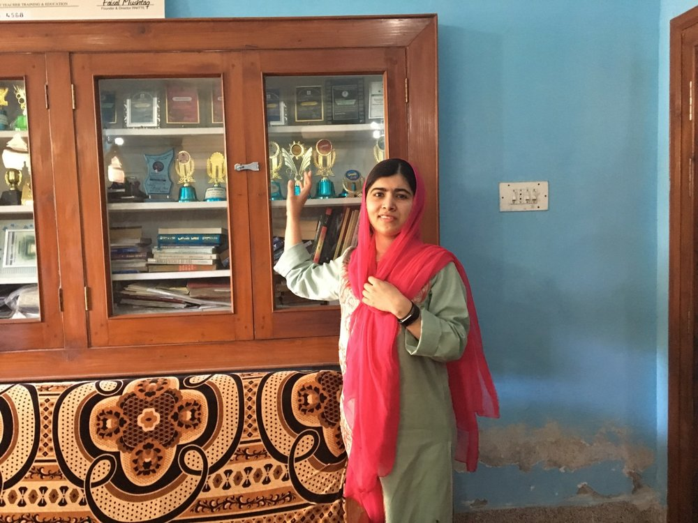 Malala with her trophies from school. (Courtesy of Insiya Syed / Malala Fund)