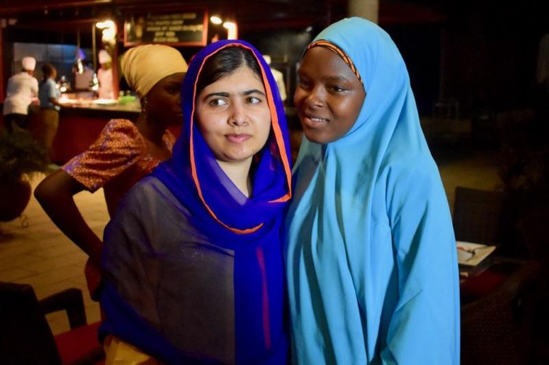 Amina reunites with Malala in Nigeira. (Courtesy of Tess Thomas / Malala Fund)