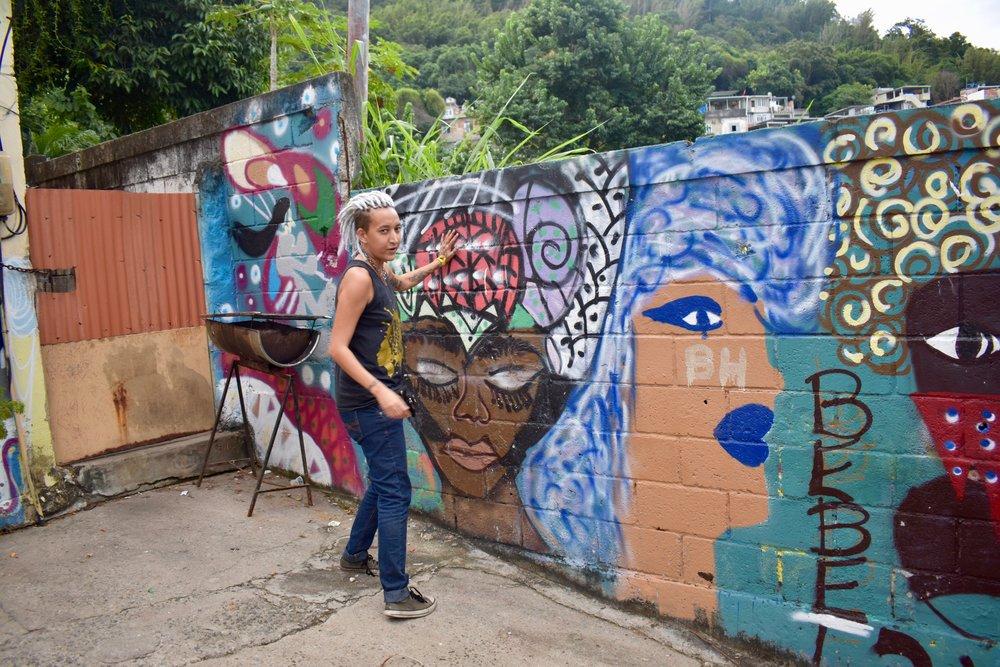 J.Lo explaining a Redi Nami mural. (Courtsey of Tess Thomas / Malala Fund)