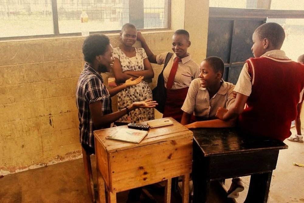 Mirabelle with students during the Sunrise School Tour in Calabar. (Courtesy of Sunrise Youth Intervention Organization)
