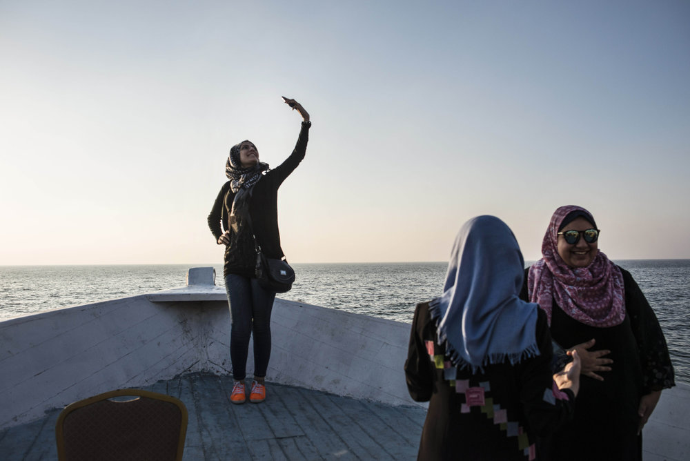 Doaa takes a selfie at a cafe on the water in Gaza. (Courtesy of Monique Jacques)