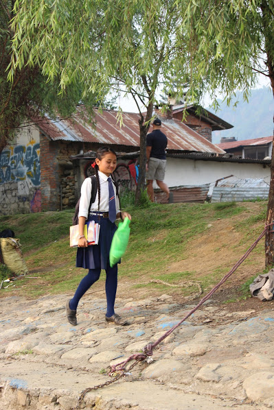 Aashma walking to her school boat. (Courtesy: Nirmal Adhikari)