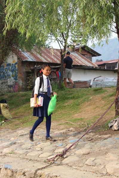 Aashma walking to her school boat. (Courtesy: Nirmal Adhikari)