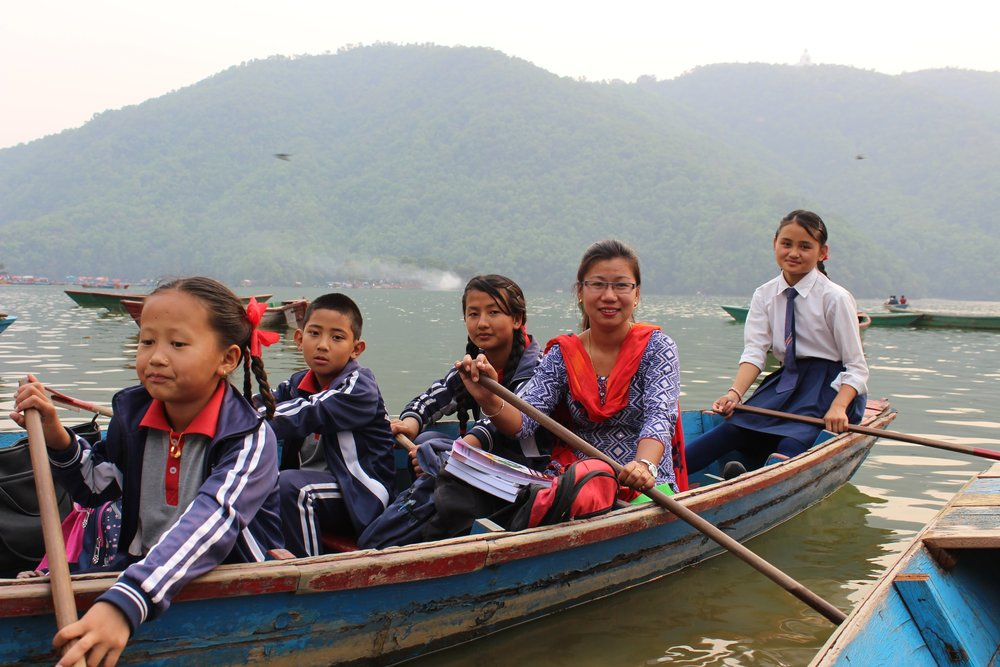 Aashma and her friends on a boat. (Courtesy: Nirmal Adhikari)