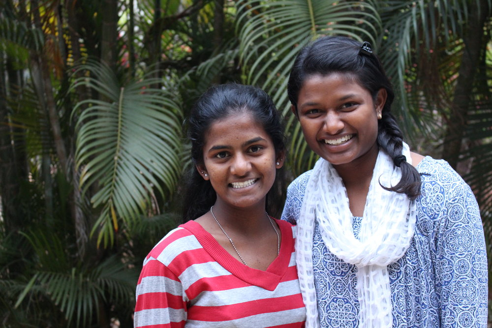 Shree (left) and Vaishali (right) at their school in India. (Courtesy of  She's the First )