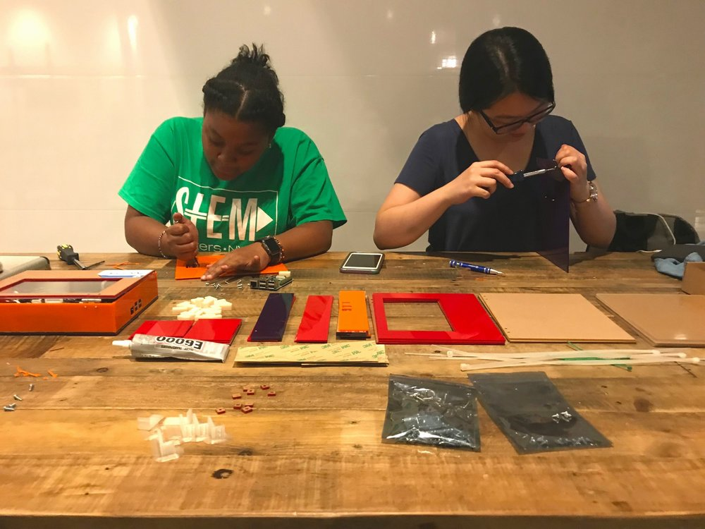 Aliana Wilson (left) and Angela Zheng (right) working on the DIY computers. (Courtesy of Karina Popovich)