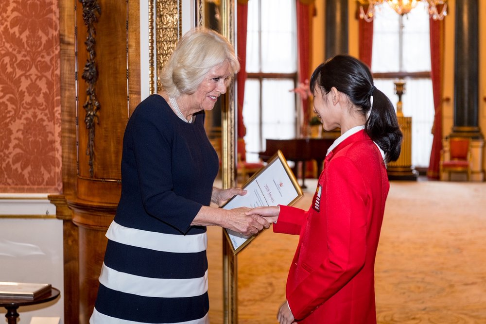 Janine Shum meeting the Duchess of Cornwall after winning The Queen's Commonwealth Essay Writing Competition — over 12,000 students from Commonwealth countries entered. (Courtesy of the Royal Commonwealth Society)