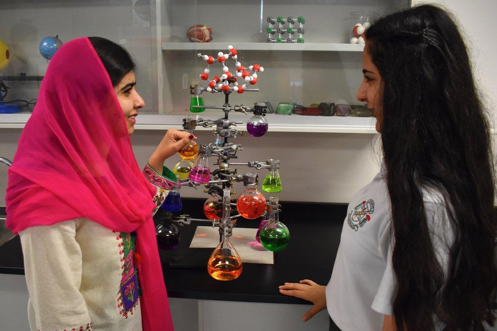 Malala visits a science class at Holroyd High School. (Courtesy of Tess Thomas / Malala Fund)