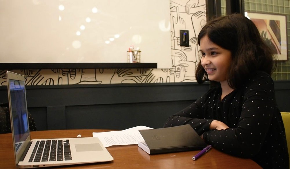 Anya interviewing Vivian on video chat. (Courtesy of Tess Thomas / Malala Fund)