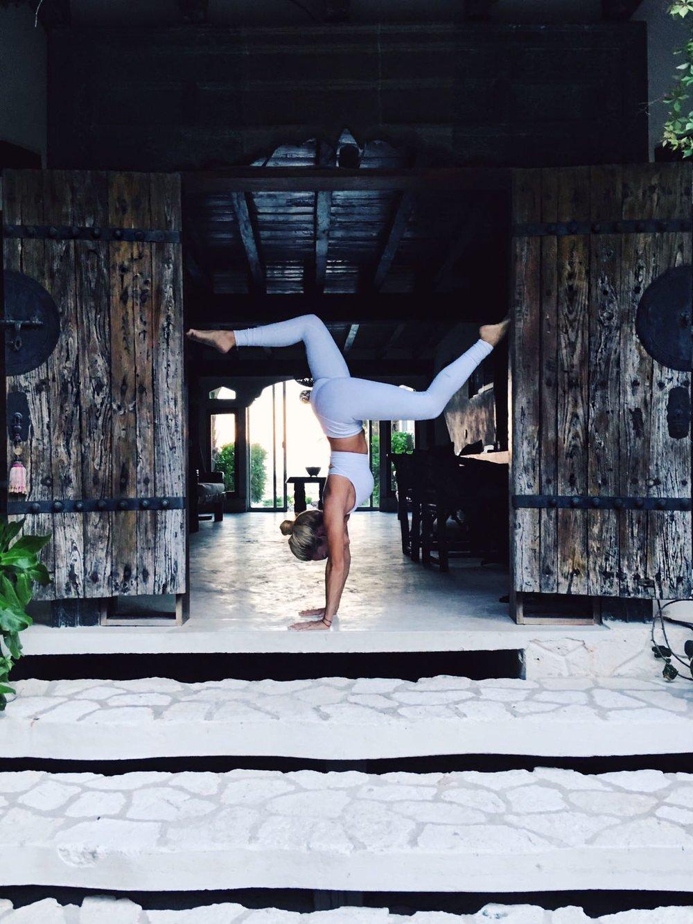 Flipped upside down in head to toe Alo Yoga