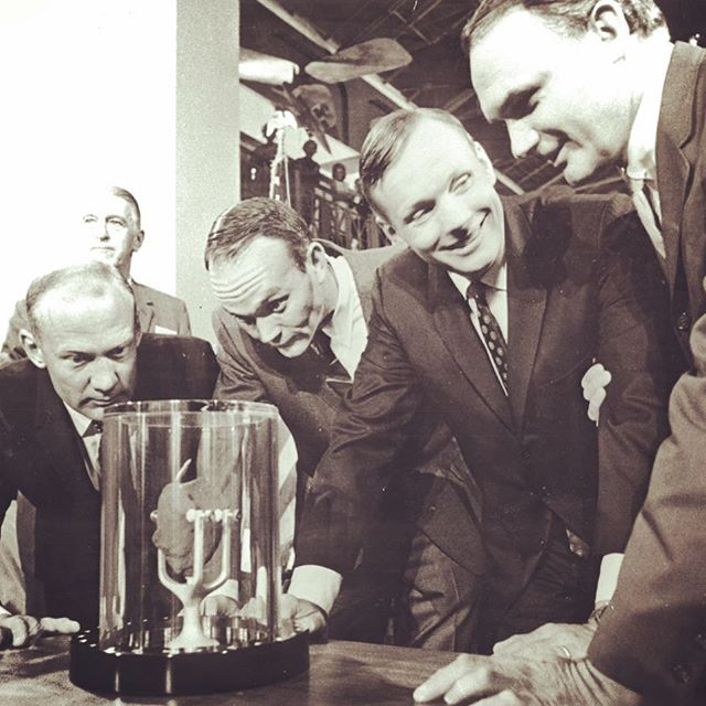 Buzz (left, intense stare), Mike (middle, only one to not set foot on the moon), Neil (casual, smiling) present a moon rock to the Smithsonian #moonfacts 🌙