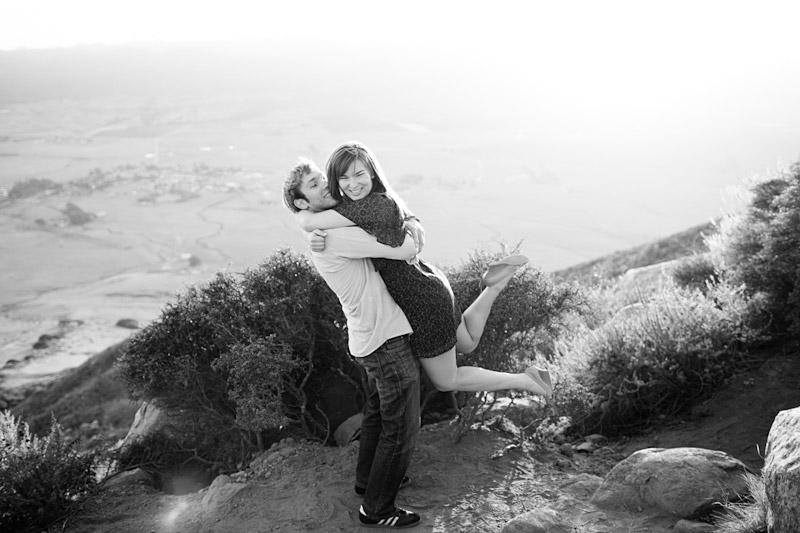 Cal Poly Couple hugging on Top of Bishops Peak