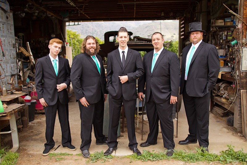 Ventura County portrait of groomsmen greaser in front of autoshop