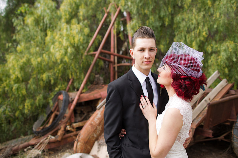 Stacy & Josh, Ventura County wedding couple portraits in front of old car parts 1 of 3