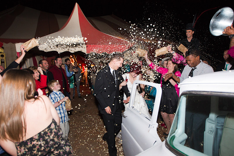 Stacy & Josh run to getaway truck after their Ventura County vintage circus wedding
