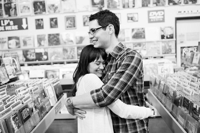 Hollywood, Wedding photography, engagement photos of couple hugging in Amoeba Music Store