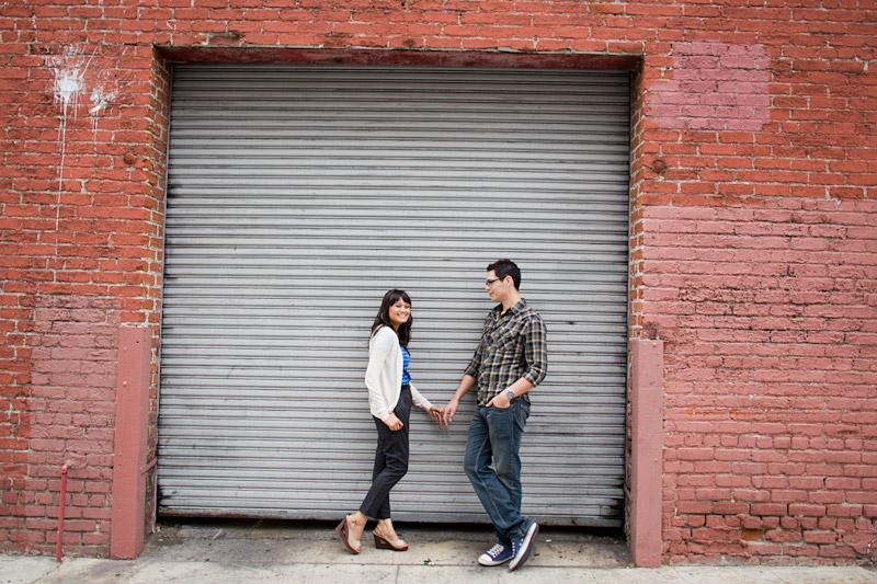 Hollywood, Wedding photography, urban engagement photos of bride and groom in front of rollup door.