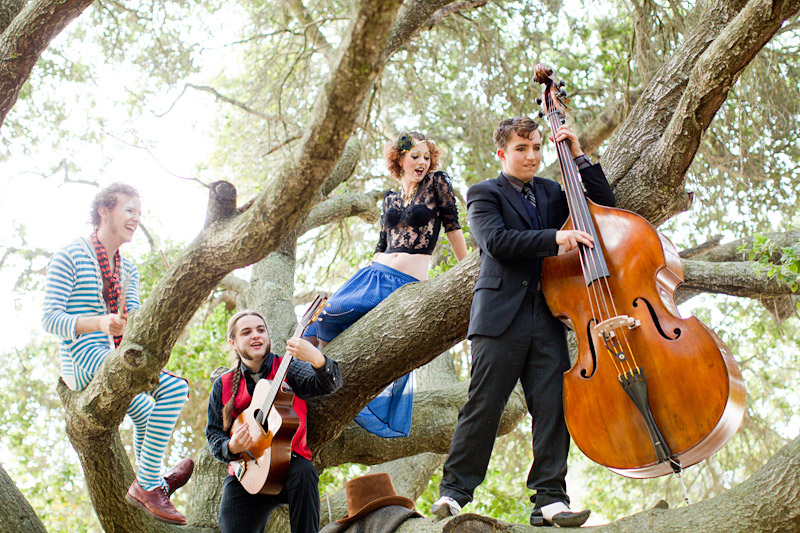 Loriana Ranch, San Luis Obispo Vintage Circus Freak Show Blue Bird inspiration shoot of Redskunk Band playing music in a tree (4 of 5)