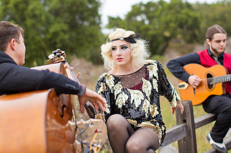 Loriana Ranch, San Luis Obispo Vintage Circus Freak Show Blue Bird inspiration shoot of musicians playing to a pretty circus performer (2 of 3)