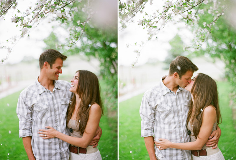 Santa Margarita Ranch, engagement photos of couple kissing under a cherry blossom tree