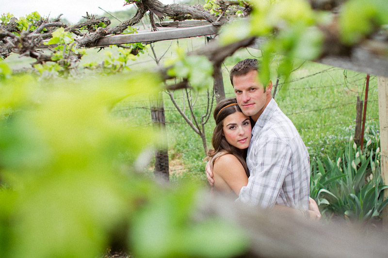 Santa Margarita Ranch, engagement photos of couple hugging under vines