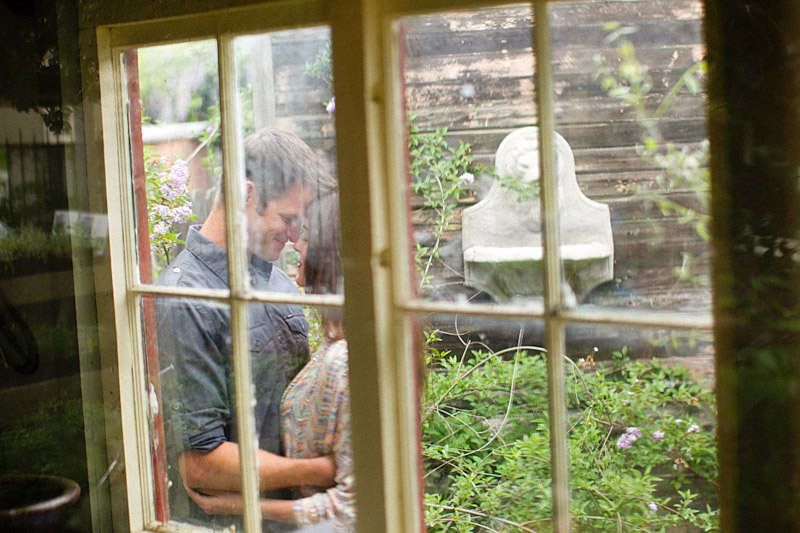 Santa Margarita, engagement photos of couple through window Educated Gardner Nursery (2 of 2)