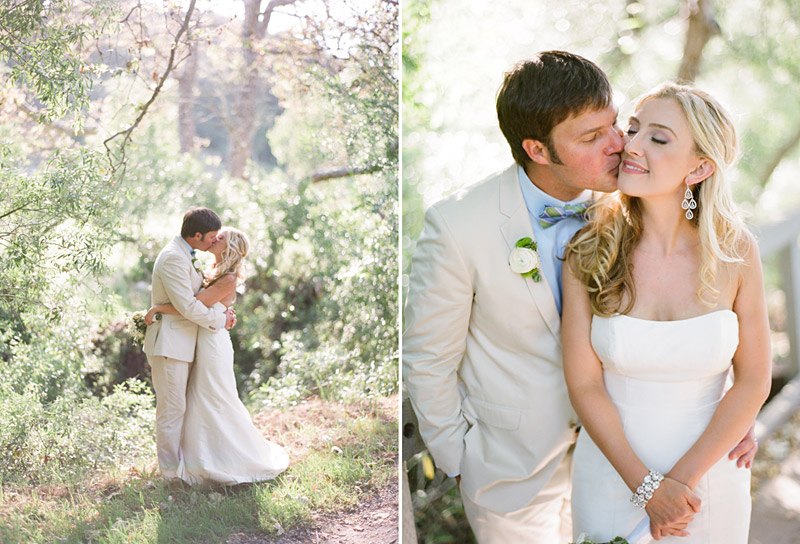 Central Coast Avila Beach Golf Course wedding pictures of bride and groom kissing in front of trees.