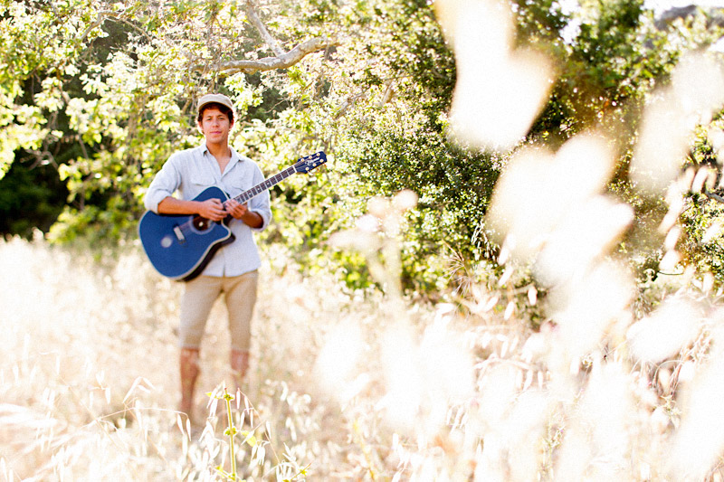 Joel VanZ central coast wedding videographer and musician hanging out in a field (7 of 8)