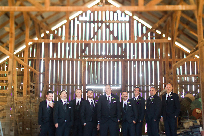 san luis obispo ranch wedding, portraits of the groomsmen in a barn