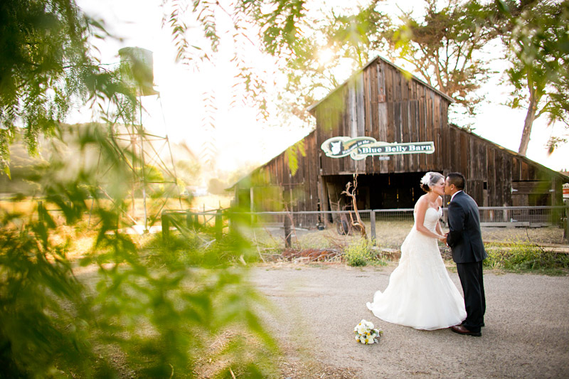 Edna valley wedding photos of bride and groom in front of a barn