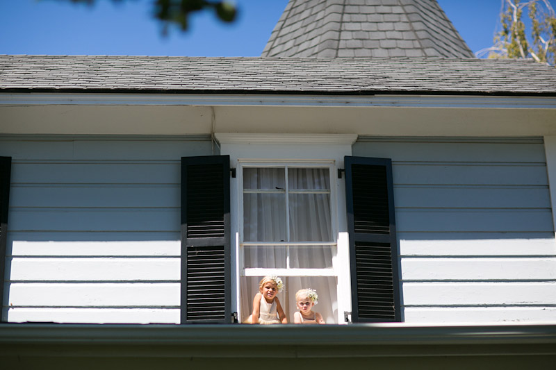 San Luis Obispo Wedding with flower girls hanging out of the window at Dana Powers House